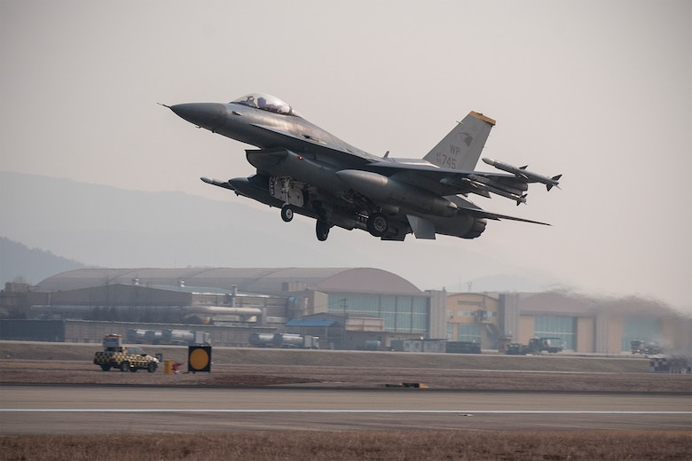 An F-16 Fighting Falcon from the 8th Fighter Wing takes off during exercise Buddy Wing 15-2 Feb. 5, 2015, at Daegu Air Base, South Korea. Buddy Wing exercises are held multiple times a year to enhance interoperability between  the U.S. and South Korean air forces, promote cultural awareness; and integrate mission planning, briefing, flying and debriefing. (U.S. Air Force photo/Senior Airman Katrina Heikkinen)