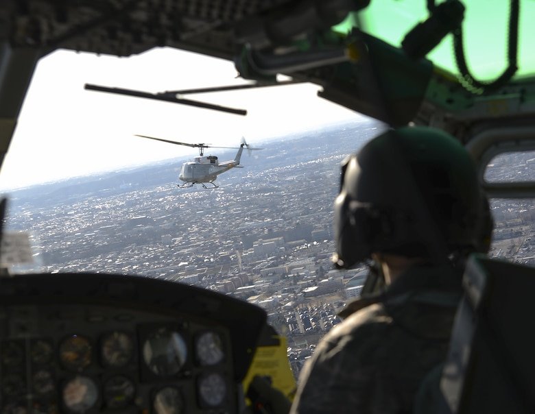 Two UH-1N Iroquois helicopters fly Jan. 29, 2015, toward Mt. Fuji, Japan. The pilots were practicing formations, maneuvers and rescue tactics with Japan Ground Self-Defense Force members. (U.S. Air Force photo/Senior Airman Michael Washburn)