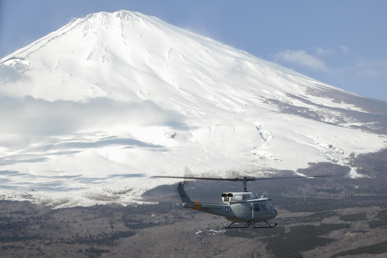 An UH-1N Iroquois flies toward Mt. Fuji during a bilateral training mission Jan. 29, 2015, near Tokyo. Two helicopters were used during the training mission, in which the pilots were able to practice formations, maneuvers and rescue tactics with Japan Ground Self-Defense Force members. (U.S. Air Force photo/Senior Airman Michael Washburn)