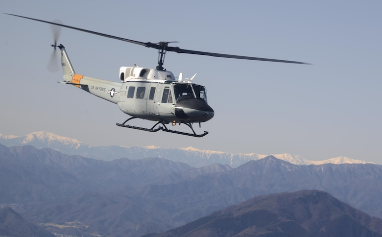 A UH-1N Iroquois helicopter flies over Japanese mountaintops on its way back to Yokota Air Base, Japan, Jan. 29, 2015, after completing a bilateral training mission. U.S. Airmen trained with Japan Ground Self-Defense Force members during the mission. (U.S. Air Force photo/Senior Airman Michael Washburn)