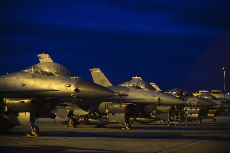 A row of U.S. Air Force F-16 Fighting Falcons remain parked on the flightline during a flying training deployment Jan. 30, 2015, at Souda Bay, Greece. The aircraft conducted the training as part of the bilateral deployment between the Hellenic and U.S. air forces to develop interoperability and cohesion between the two NATO partners. The F-16s are assigned to the 480th Expeditionary Fighter Squadron. (U.S. Air Force photo/Staff Sgt. Joe W. McFadden)