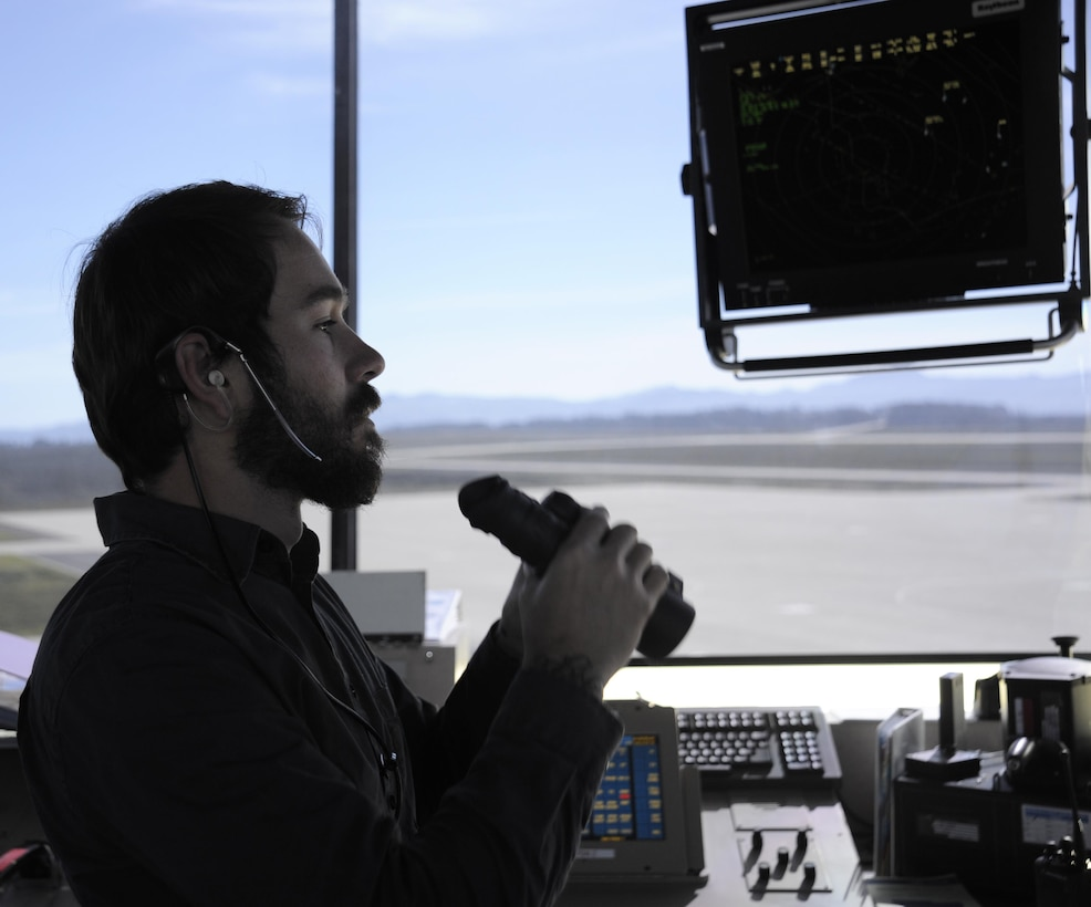 Robert Moore scans the runway for foreign objects from the control tower Feb. 2, 2015, at Vandenberg Air Force Base, Calif. Though not as busy as aircraft-centric bases, the Vandenberg AFB airfield serves as a central hub for the delivery of components for the base's primary space mission. Moore is a 30th Operations Support Squadron air traffic control specialist. (U.S. Air Force photo/Airman 1st Class Ian Dudley)