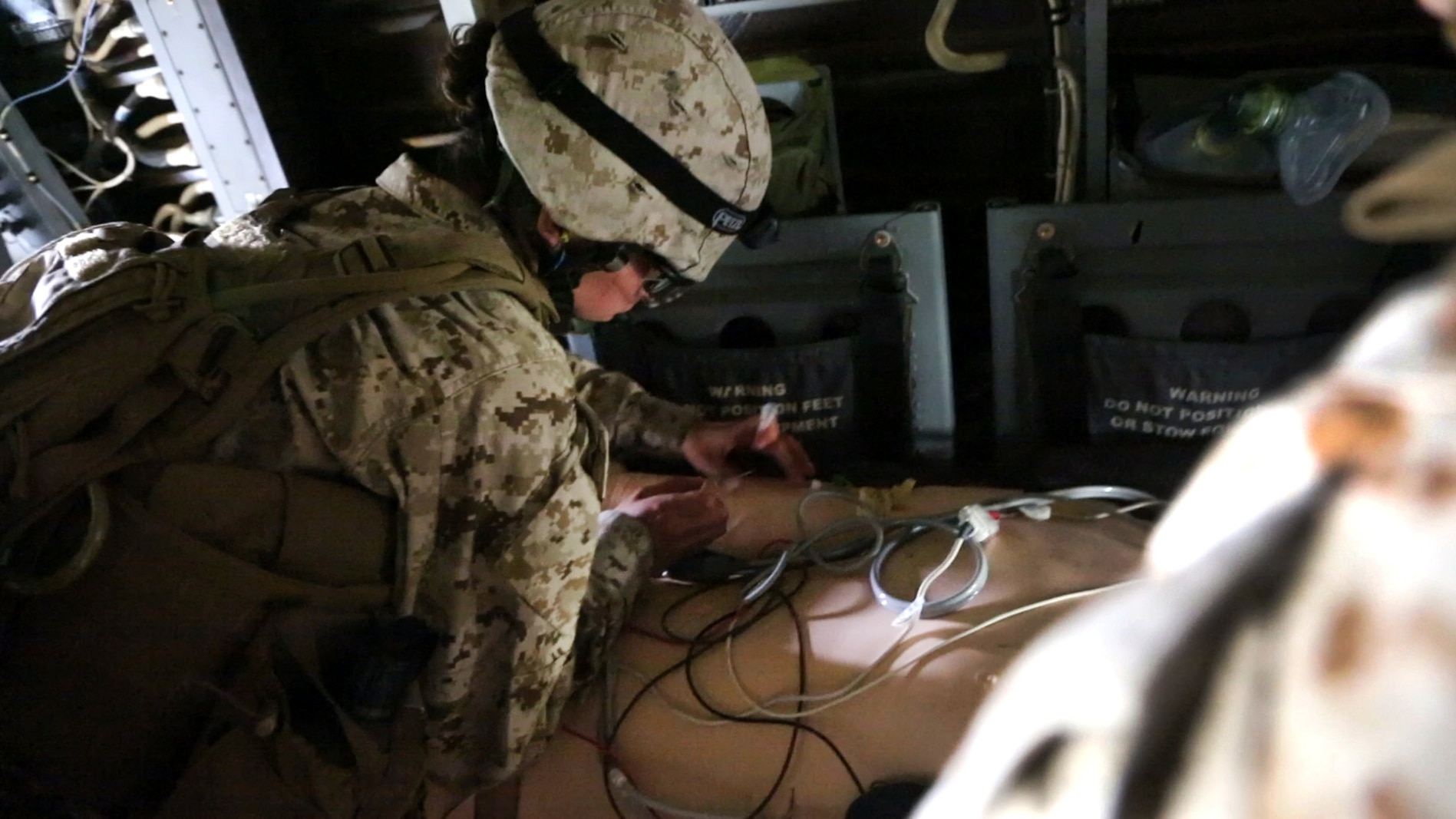 A corpsman with Alpha Surgical Company, 1st Medical Battalion, 1st Marine Logistics Group, treats a simulated casualty during an en-route care exercise aboard Camp Pendleton, Calif., Jan. 28, 2015. During the four-day exercise, corpsmen trained to prepare a Special-Purpose Marine Air-Ground Task Force group that is going to forward deploy later this year. The more than 40 corpsmen set up a shock trauma platoon facility, or mobile emergency room, to treat simulated casualties. The casualties were stabilized in the STP and then flown out via aircraft. (U.S. Marine Corps photo by Sgt. Laura Gauna/Released)