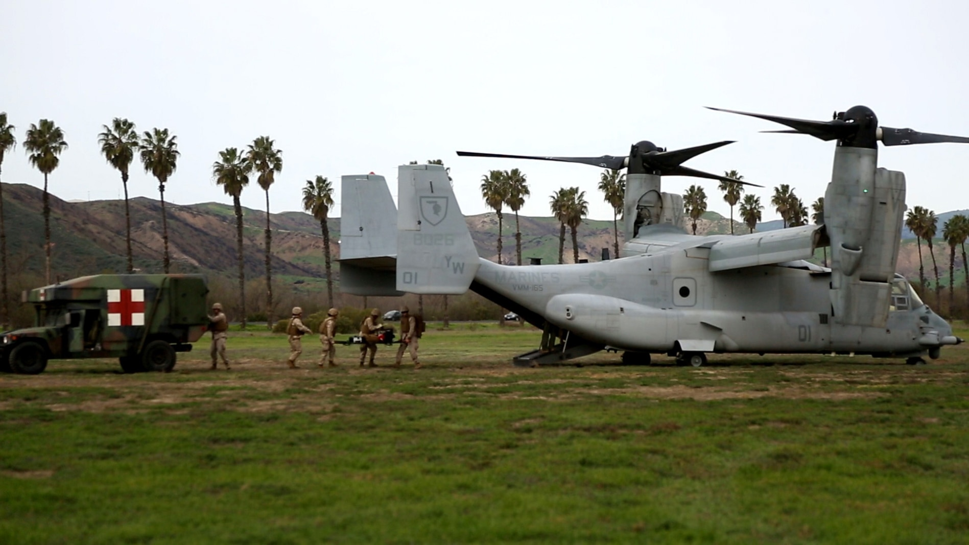 Corpsmen with Alpha Surgical Company, 1st Medical Battalion, 1st Marine Logistics Group, transfer a simulated casualty onto an MV-22 Osprey during an en-route care exercise aboard Camp Pendleton, Calif., Jan. 28, 2015. During the four-day exercise, corpsmen trained to prepare a Special-Purpose Marine Air-Ground Task Force group that is going to forward deploy later this year. The more than 40 corpsmen set up a shock trauma platoon facility, or mobile emergency room, to treat simulated casualties. The casualties were stabilized in the STP and then flown out via aircraft. (U.S. Marine Corps photo by Sgt. Laura Gauna/Released)