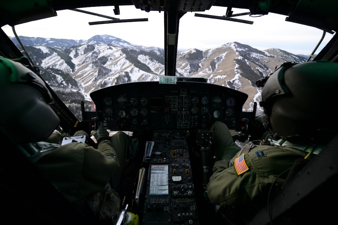 First Lt. Greg Johnston and Capt. RJ Bergman fly their UH-1N Iroquois over a mountain range Jan. 27, 2015, near Malmstrom Air Force Base, Mont. The flight took the crew over a variety of terrain and altitudes, from flatlands to valleys and mountains. Both Airmen are 40th Helicopter Squadron rescue pilots. (U.S. Air Force photo/Airman 1st Class Dillon Johnston)