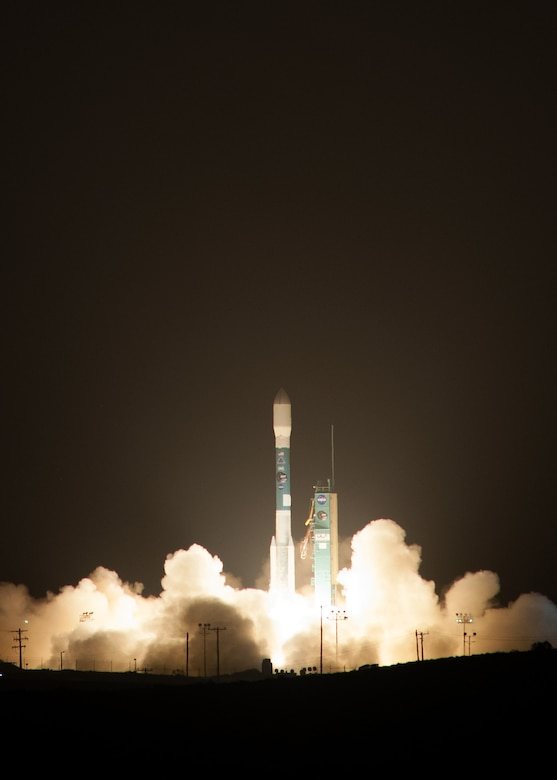 A United Launch Alliance Delta II rocket successfully launches from Vandenberg Air Force Base Space Launch Complex-2, Jan. 31, 2015 at 6:22 a.m. PDT. This Delta II rocket carried NASA's Soil Moisture Active Passive; the first Earth observing satellite. SMAP is designed to collect global observations of surface soil moisture and its freeze/thaw state. High resolution space-based measurements of soil moisture and whether the soil is frozen or thawed will give scientists a new capability to observe and predict natural hazards of extreme weather, climate change, floods and droughts, and will help reduce uncertainties in the understanding of Earth's water and carbon cycles. (U.S. Air Force photo by Michael Peterson)