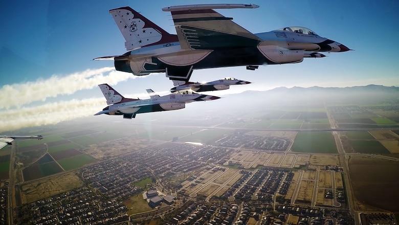 Thunderbirds pilots approach the University of Phoenix Stadium Feb. 1, 2015, to perform a flyover during Super Bowl XLIX, in Phoenix. (U.S. Air Force photo/Tech. Sgt. Manuel J. Martinez)