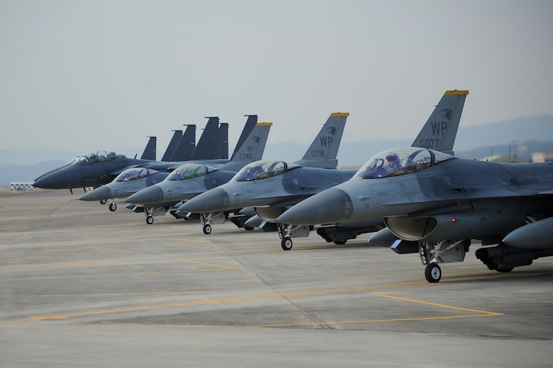 Four F-16 Fighting Falcons and four F-15K Slam Eagles prepare to take off to conduct their first aerial formation training scenario during exercise Buddy Wing 15-2, Feb. 3, 2015, at Daegu Air Base, South Korea. Buddy Wing exercises are part of a combined fighter exchange program designed to improve interoperability between U.S. Air Force and South Korean air force fighter units. (U.S. Air Force photo/Senior Airman Divine Cox)