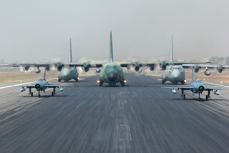 Two Bangladesh air force (BAF) F-7BG Defenders, a BAF C-130B Hercules, and two U.S. Air Force C-130H Hercules aircraft prepare to take off Jan. 28, 2015, from BAF Base Bangabandhu, Bangladesh, during exercise Cope South. Cope South is a Pacific Air Forces-sponsored, bilateral tactical airlift exercise conducted in Bangladesh, with a focus on cooperative flight operations, day and night low-level navigation, tactical airdrop, and air-land missions as well as subject matter expert exchanges in the fields of operations, maintenance and rigging disciplines. The C-130H is assigned to the 374th Airlift Wing at Yokota Air Base, Japan. (Courtesy photo/Bangladesh air force)