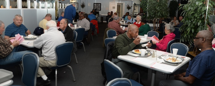 Retired service members from every branch of the armed forces visit with one another, Feb. 4, for the installation's monthly Retiree Breakfast, which was held at Marine Corps Logistics Base Albany's Town and Country Restaurant.