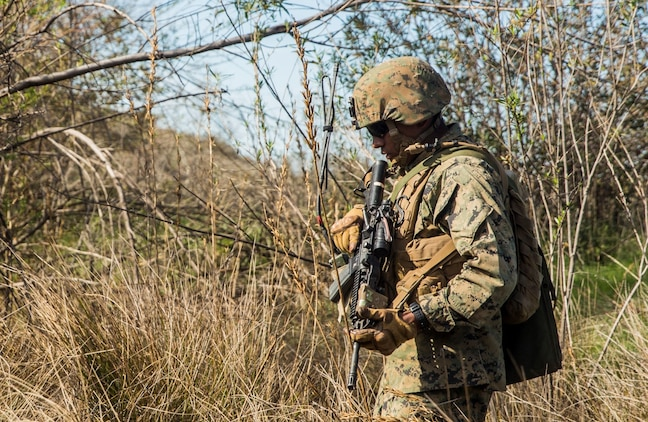 U.S. Marine Cpl. Jorge Castro patrols with his squad during squad tactics and maneuver training aboard Camp Pendleton, Calif., Jan. 27, 2015. Castro is a section leader with Kilo Company, Battalion Landing Team 3rd Battalion, 1st Marine Regiment, 15th Marine Expeditionary Unit. As the ground combat element for the 15th MEU, BLT 3/1 is preparing for their upcoming deployment by enhancing their combat skills and learning to work as a cohesive unit. (U.S. Marine Corps Photo by Sgt. Emmanuel Ramos/Released)