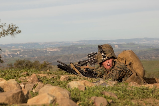 U.S. Marine Lance Cpl. Raul Fosselman gives directions during squad tactics and maneuver training aboard Camp Pendleton, Calif., Jan. 28, 2015. Fosselman is a team leader with Kilo Company, Battalion Landing Team 3rd Battalion, 1st Marine Regiment, 15th Marine Expeditionary Unit. As the ground combat element for the 15th MEU, BLT 3/1 is preparing for their upcoming deployment by enhancing their combat skills and learning to work as a cohesive unit. (U.S. Marine Corps Photo by Sgt. Emmanuel Ramos/Released)