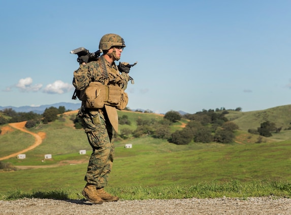 U.S. Marine Lance Cpl. Alexander Basco patrols with his squad during squad tactics and maneuver training aboard Camp Pendleton, Calif., Jan. 27, 2015. Basco is a machine gunner with Kilo Company, Battalion Landing Team 3rd Battalion, 1st Marine Regiment, 15th Marine Expeditionary Unit. As the ground combat element for the 15th MEU, BLT 3/1 is preparing for their upcoming deployment by enhancing their combat skills and learning to work as a cohesive unit. (U.S. Marine Corps Photo by Sgt. Emmanuel Ramos/Released)