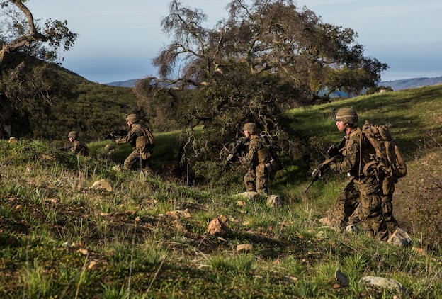 U.S. Marines with Kilo Company, Battalion Landing Team 3rd Battalion, 1st Marine Regiment, 15th Marine Expeditionary Unit, advance to their objective during squad tactics and maneuver training aboard Camp Pendleton, Calif., Jan. 28, 2015. As the ground combat element for the 15th MEU, BLT 3/1 is preparing for their upcoming deployment by enhancing their combat skills and learning to work as a cohesive unit. (U.S. Marine Corps Photo by Sgt. Emmanuel Ramos/Released)