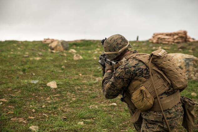 U.S. Marine Lance Cpl. Alexander Dalziel engages targets during squad tactics and maneuver training aboard Camp Pendleton, Calif., Jan. 29, 2015. Daziel is a team leader with Kilo Company, Battalion Landing Team 3rd Battalion, 1st Marine Regiment, 15th Marine Expeditionary Unit. As the ground combat element for the 15th MEU, BLT 3/1 is preparing for their upcoming deployment by enhancing their combat skills and learning to work as a cohesive unit. (U.S. Marine Corps Photo by Sgt. Emmanuel Ramos/Released)