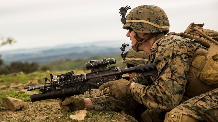 U.S. Marine Lance Cpl. Alexander Dalziel asses enemy threat during squad tactics and maneuver training aboard Camp Pendleton, Calif., Jan. 29, 2015. Dalziel is a team leader with Kilo Company, Battalion Landing Team 3rd Battalion, 1st Marine Regiment, 15th Marine Expeditionary Unit. As the ground combat element for the 15th MEU, BLT 3/1 is preparing for their upcoming deployment by enhancing their combat skills and learning to work as a cohesive unit. (U.S. Marine Corps Photo by Sgt. Emmanuel Ramos/Released)