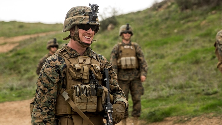 U.S. Marine Lance Cpl.  Alexander Dalziel shares a moment of laughter with his fire team during squad tactics and maneuver training aboard Camp Pendleton, Calif., Jan. 29, 2015. Dalziel is a team leader with Kilo Company, Battalion Landing Team 3rd Battalion, 1st Marine Regiment, 15th Marine Expeditionary Unit. As the ground combat element for the 15th MEU, BLT 3/1 is preparing for their upcoming deployment by enhancing their combat skills and learning to work as a cohesive unit. (U.S. Marine Corps Photo by Sgt. Emmanuel Ramos/Released)