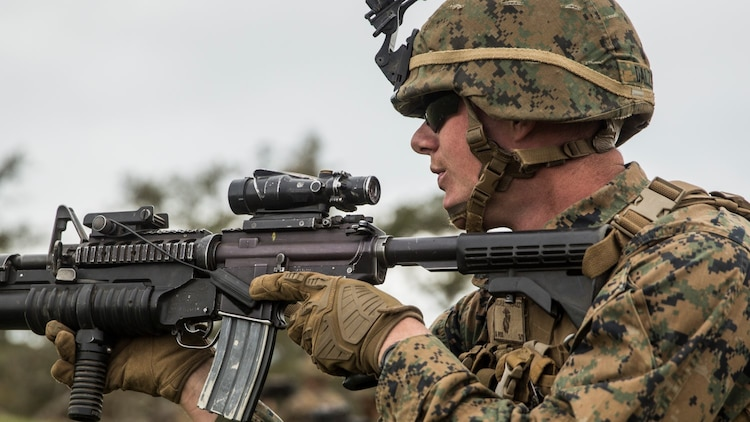 U.S. Marine Lance Cpl. Alexander Dalziel assesses enemy threat during squad tactics and maneuver training aboard Camp Pendleton, Calif., Jan. 29, 2015. Dalziel is a team leader with Kilo Company, Battalion Landing Team 3rd Battalion, 1st Marine Regiment, 15th Marine Expeditionary Unit. As the ground combat element for the 15th MEU, BLT 3/1 is preparing for their upcoming deployment by enhancing their combat skills and learning to work as a cohesive unit. (U.S. Marine Corps Photo by Sgt. Emmanuel Ramos/Released)