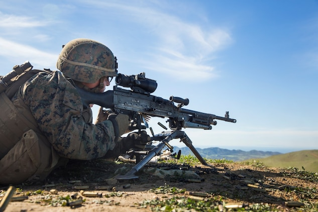 U.S. Marine Lance Cpl. Alexander Basco engages targets with his M240B machine gun during squad tactics and maneuver training aboard Camp Pendleton, Calif., Jan. 27, 2015. Bosco is a rifleman with Kilo Company, Battalion Landing Team 3rd Battalion, 1st Marine Regiment, 15th Marine Expeditionary Unit. As the ground combat element for the 15th MEU, BLT 3/1 is preparing for their upcoming deployment by enhancing their combat skills and learning to work as a cohesive unit. (U.S. Marine Corps Photo by Sgt. Emmanuel Ramos/Released)