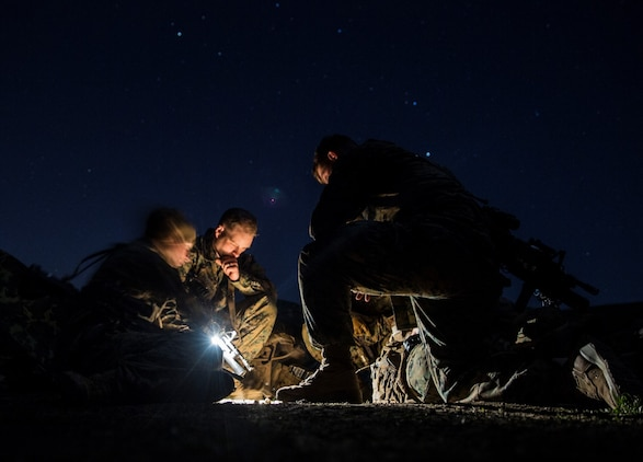 U.S. Marines with Kilo Company, Battalion Landing Team 3rd Battalion, 1st Marine Regiment, 15th Marine Expeditionary Unit, plan a mission during squad tactics and maneuver training aboard Camp Pendleton, Calif., Jan. 27, 2015. As the ground combat element for the 15th MEU, BLT 3/1 is preparing for their upcoming deployment by enhancing their combat skills and learning to work as a cohesive unit. (U.S. Marine Corps Photo by Sgt. Emmanuel Ramos/Released)