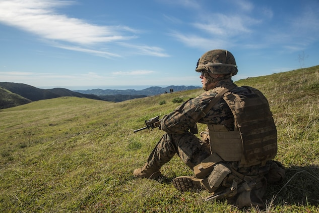 U.S. Marine Pfc. Jacob Westbrook provides security during squad tactics and maneuver training exercise aboard Camp Pendleton, Calif., Jan. 27, 2015. Pfc. Westbrook is a rifleman with Kilo Company, Battalion Landing Team 3rd Battalion, 1st Marine Regiment, 15th Marine Expeditionary Unit. As the ground combat element for the 15th MEU, BLT 3/1 is preparing for their upcoming deployment by enhancing their combat skills and learning to work as a cohesive unit. (U.S. Marine Corps Photo by Sgt. Emmanuel Ramos/Released)