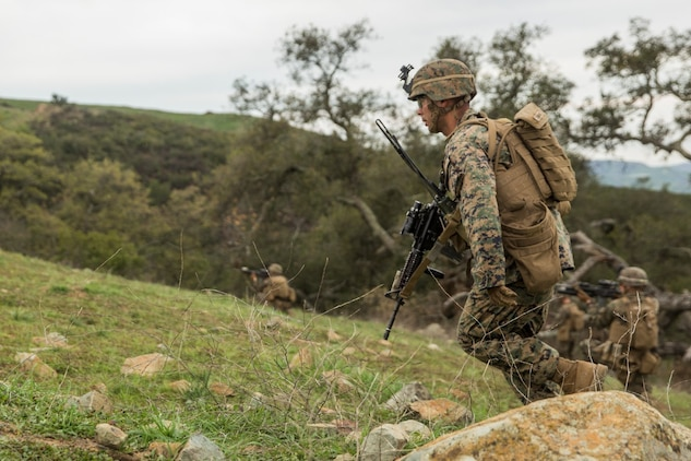 U.S. Marine Sgt. Juan Zamora moves under fire during squad tactics and maneuver training aboard Camp Pendleton, Calif., Jan. 29, 2015. Zamora is a squad leader Kilo Company, Battalion Landing Team 3rd Battalion, 1st Marine Regiment, 15th Marine Expeditionary Unit. As the ground combat element for the 15th MEU, BLT 3/1 is preparing for their upcoming deployment by enhancing their combat skills and learning to work as a cohesive unit. (U.S. Marine Corps Photo by Sgt. Emmanuel Ramos/Released)