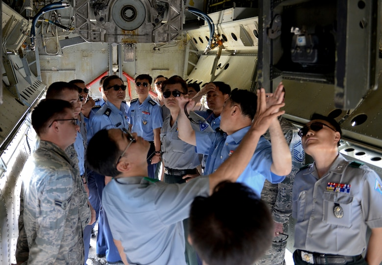 A group of Republic of Korea generals and admirals observe a B-52 Stratofortress bomb bay Jan. 30, 2015, at Andersen Air Force Base, Guam, as part of a Korea National Defense University capstone event. The course, which is designed for newly appointed flag officers, educates participants on key issues and capabilities of allied nations in the Pacific. (U.S. Air Force photo by Staff Sgt. Robert Hicks/Released)