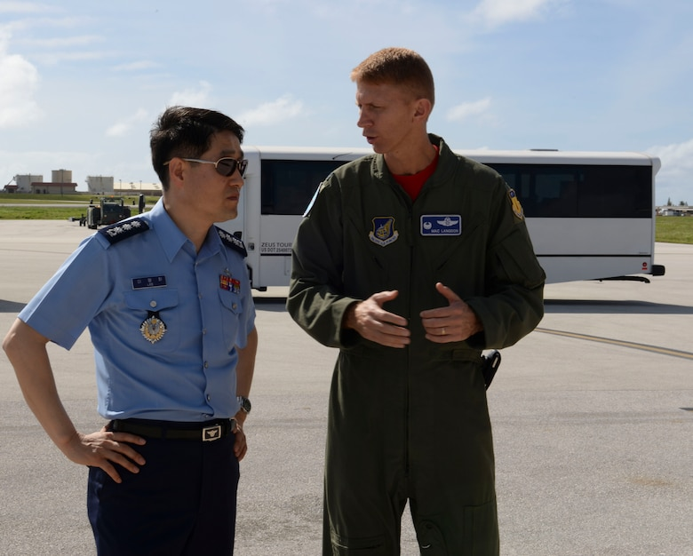 U.S. Air Force Col. Reid Langdon, 36th Operations Group commander, discusses Andersen missions to a member of a Korean National Defense University class composed of nearly 100 new generals and admirals Jan. 30, 2015, at Andersen Air Force Base, Guam. The class visited Andersen as a capstone event that allowed them to meet with U.S. military leaders both at Andersen and U.S. Pacific Command at Joint Base Pearl Harbor-Hickam, Hawaii, to learn about key issues and capabilities. (U.S. Air Force photo by Staff Sgt. Robert Hicks/Released)