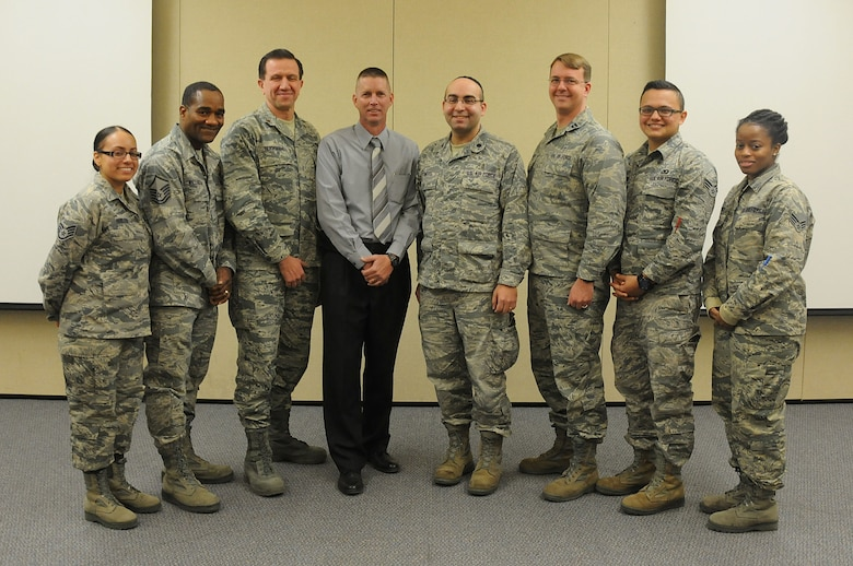Airmen from the 108th Wing chaplain office pose for a picture at the end of the Traumatic Event Management Course Jan. 16, 2015, at Joint Base McGuire-Dix-Lakehurst, N.J. The Army's TEM course was a week long and focused on unit cohesion and effectiveness to help manage crisis situations. The course used group activities and role playing to reinforce the lessons. At the end of the week, the students are able to take what they learned and bring it back to their units. (U.S. Air National Guard Photo by Airman 1st Class Julia Pyun/Released)