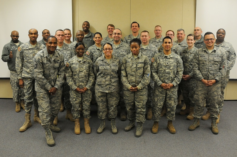 Army and Air Force chaplains and chaplain assistants from all over N.J., pose for a picture at the end of the Traumatic Event Management Course Jan. 16, 2015, at Joint Base McGuire-Dix-Lakehurst, N.J. The Army's TEM course was a week long and focused on unit cohesion and effectiveness to help manage crisis situations. The course used group activities and role playing to reinforce the lessons. At the end of the week, the students are able to take what they learned and bring it back to their units. (U.S. Air National Guard Photo by Airman 1st Class Julia Pyun/Released)