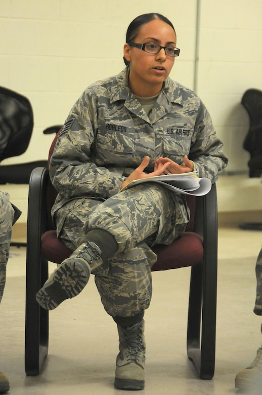 Staff Sgt. Jennifer Robledo, a future chaplain assistant from the 108th Wing, facilitates a simulated discussion during the Traumatic Event Management Course Jan. 16, 2015, at Joint Base McGuire-Dix-Lakehurst, N.J. The scenario discussion took place after a fictitious plane crash. The Army's TEM course is a week long and focuses on unit cohesion and effectiveness to help manage crisis situations. The course focuses on group activities and role playing to reinforce the lessons. At the end of the week, the students are able to take what they learned and bring it back to their units. (U.S. Air National Guard Photo by Airman 1st Class Julia Pyun/Released)