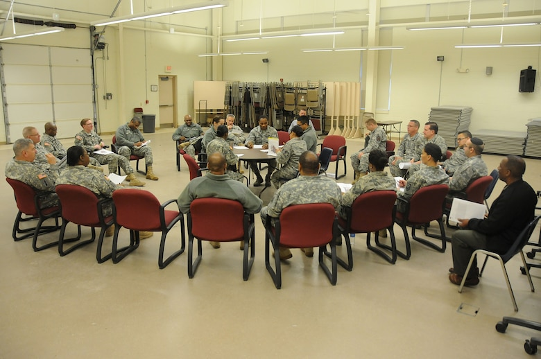 Army and Air Force chaplains and chaplain assistants from all over N.J., sit at a simulated discussion during the Traumatic Event Management course Jan. 16, 2015, at Joint Base McGuire-Dix-Lakehurst, N.J. The scenario discussion took place after a fictitious plane crash. The Army's TEM course was a week long and focused on unit cohesion and effectiveness to help manage crisis situations. The course used on group activities and role playing to reinforce the lessons. At the end of the week, the students are able to take what they learned and bring it back to their units. (U.S. Air National Guard Photo by Airman 1st Class Julia Pyun/Released)