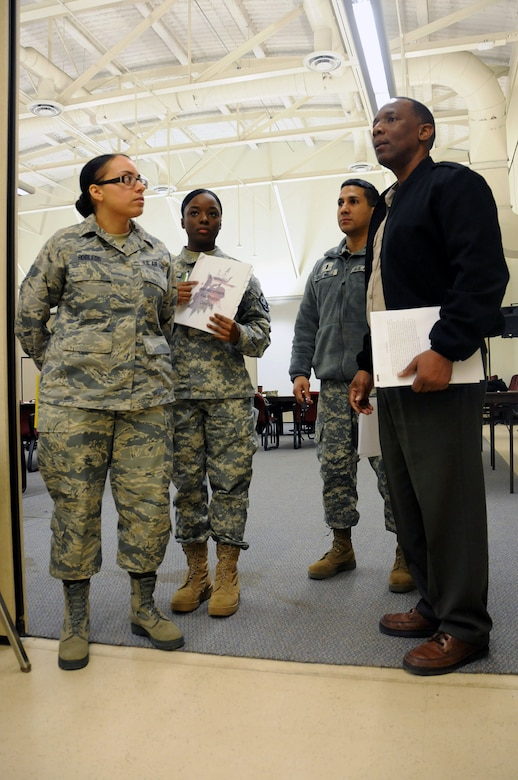 Air Force Staff Sgt. Jennifer Robledo, a future chaplain assistant from the 108th Wing, left, Army Pfc. Mahalia Reevey, a chaplain's assistant from the 117th Combat Sustainment Support Battalion, center left, Army 1st Lt. Joseph Del Valle, a chaplain from the 102nd Cavalry Regimnet, and an instructor from (AMEDDC), are waiting to start the scenario discussion during the Traumatic Event Management Course Jan. 16, 2015, at Joint Base McGuire-Dix-Lakehurst, N.J. The Army's TEM course was a week long and focused on unit cohesion and effectiveness to help manage crisis situations. The course used group activities and role playing to reinforce the lessons. At the end of the week, the students are able to take what they learned and bring it back to their units. (U.S. Air National Guard Photo by Airman 1st Class Julia Pyun/Released)