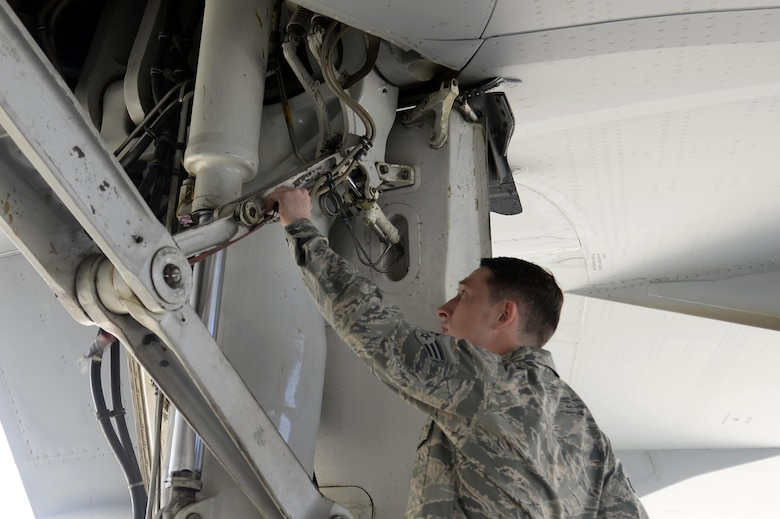 Senior Airman Will, KC-10 Extender instrument and flight control systems technician, preforms a preflight inspection on a KC-10 Extender at an undisclosed location in Southwest Asia Feb. 2, 2015. KC-10 Extenders deliver much-needed gas to help defend the nation, which begins with a hard-working team of Airmen consisting of crew chiefs and specialists. Will is deployed from Travis Air Force Base, Calif., and is a native of Glendale, Ariz. (U.S. Air Force photo/Tech. Sgt. Marie Brown)