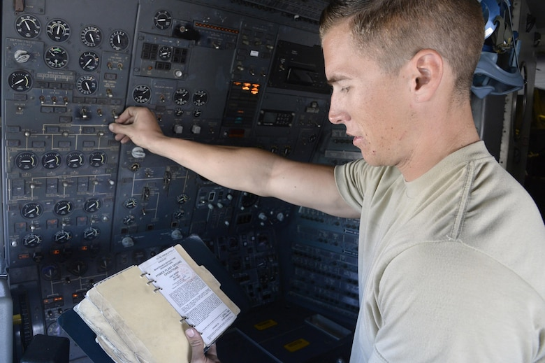 Airman 1st Class Taylor, KC-10 Extender crew chief, reads from his technical order during a preflight inspection aboard a KC-10 Extender at an undisclosed location in Southwest Asia Feb. 2, 2015.  Crew chiefs marshals, look over, inspect, and refuel the aircraft as well as making sure it is ready for another mission. Taylor is currently deployed from Travis Air Force Base, Calif., and is a native of Belleview, S.D. (U.S. Air Force photo/Tech. Sgt. Marie Brown)