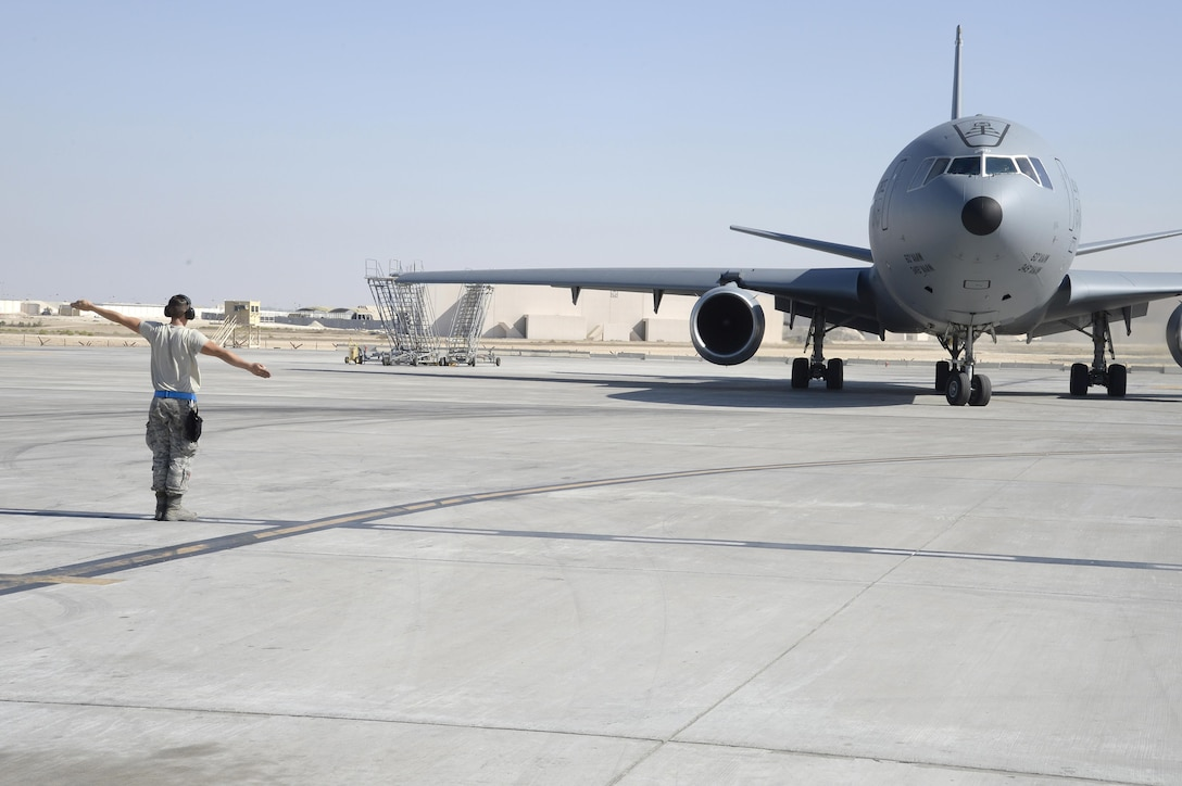 Airman 1st Class Taylor, KC-10 Extender crew chief, marshals out a KC-10 Extender at an undisclosed location in Southwest Asia Feb. 2, 2015. Since the beginning of Operation Inherent Resolve the KC-10 Extender has supplied over 150 million pounds of fuel to a variety of U.S. and allied military aircraft. Taylor is currently deployed from Travis Air Force Base, Calif., and is a native of Belleview, S.D. (U.S. Air Force photo/Tech. Sgt. Marie Brown)