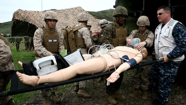 Corpsmen with Alpha Surgical Company, 1st Medical Battalion, 1st Marine Logistics Group, treat a simulated casualty during an en-route care exercise aboard Camp Pendleton, Calif., Jan. 28, 2015. During the four-day exercise, corpsmen trained to prepare a Special-Purpose Marine Air-Ground Task Force group that is going to forward deploy later this year. The more than 40 corpsmen set up a shock trauma platoon facility, or mobile emergency room, to treat simulated casualties. The casualties were stabilized in the STP and then flown out via aircraft. (U.S. Marine Corps photo by Sgt. Laura Gauna/Released)
