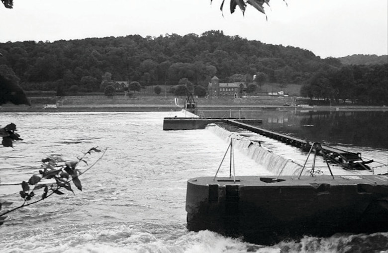 This archive photo offers a view of Lock 18, a wicket lock and dam on the Ohio River between Marietta, OH, and Parkersburg, W.Va. This view is from the West Virginia side. The lock was replaced by the Belleville Locks and Dam.