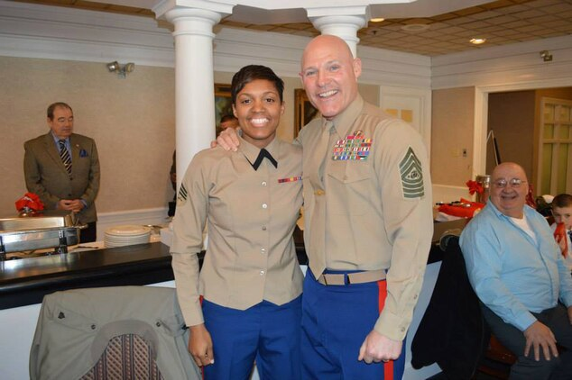 Sgt. Candice Clark-Thomas, operations noncommissioned officer, Marine Corps Systems Command, at Marine Corps Logistics Base Albany, was named the 2014 Marine Female Athlete of the Year and attends a ceremony at Marine Corps Base Quantico, Virginia, to receive her award. Sgt. Maj. Micheal P. Barrett, Sergeant Major of the Marine Corps, posed with her.