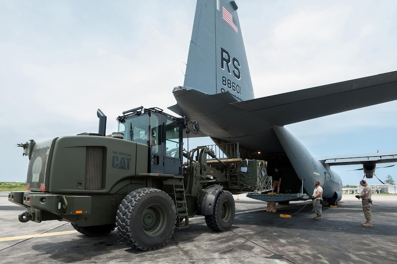 Aerial porters from the Kentucky Air National Guard's 123rd Contingency Response Group load a pallet of red blood cells and frozen plasma Oct. 10, 2014, onto a C-130 Hercules aircraft from Ramstein Air Base, Germany, at Léopold Sédar Senghor International Airport in Dakar, Senegal. The aerial porters are part of Joint Task Force-Port Opening Senegal, an air cargo hub that's funneling humanitarian supplies and equipment into West Africa in support of Operation United Assistance, the U.S. Agency for International Development-led, whole-of-government effort to respond to the Ebola outbreak there. (U.S. Air National Guard photo/Maj. Dale Greer)