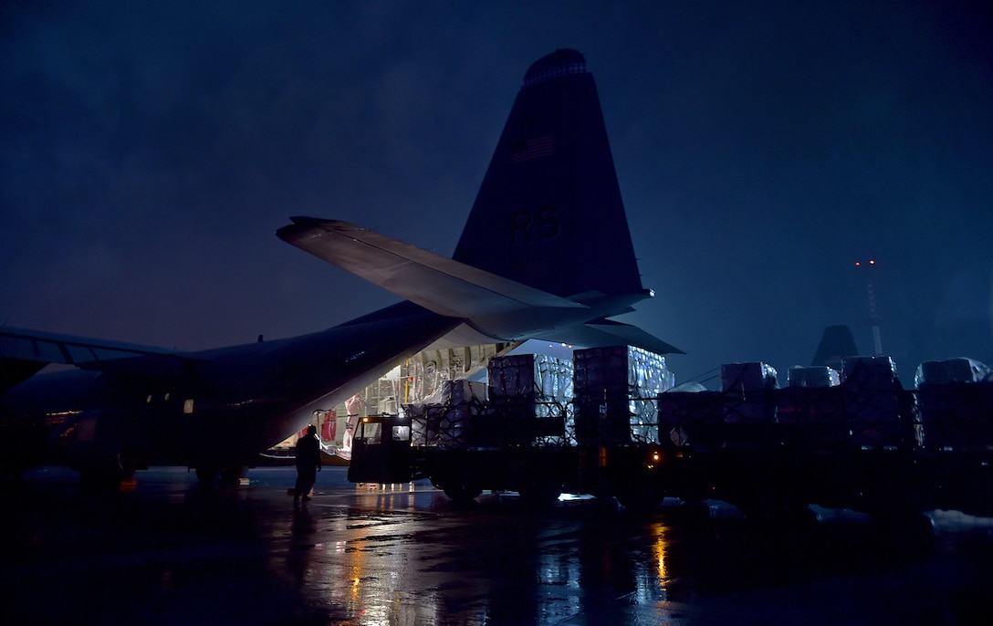 Cargo is loaded onto the ramp of a C-130-J Super Hercules Oct. 7, 2014, at Ramstein Air Base, Germany. As the Ebola outbreak becomes a potential global threat, U.S. Africa Command is working in support of the U.S. Agency for International Development, the lead federal agency, as part of a comprehensive U.S. government effort to respond to and contain the outbreak of the Ebola virus in West Africa as quickly as possible. This was the first flight launched from Ramstein AB to Monrovia, Liberia, in support of Operation United Assistance. (U.S. Air Force photo/Staff Sgt. Sara Keller)