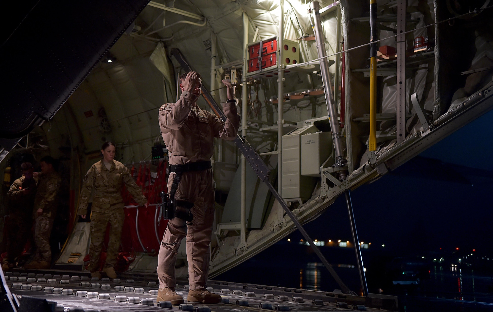 Senior Airman Christian McDevitt leads a cargo loader to a C-130J Super Hercules prior to a mission in support of the Ebola virus epidemic Oct. 7, 2014, at Ramstein Air Base, Germany. U.S. Africa Command is working in support of the U.S. Agency for International Development, the lead federal agency, as part of a comprehensive U.S. Government effort to respond to and contain the outbreak of the Ebola virus in West Africa as quickly as possible. This was the first C-130J Super Hercules flight launched from Ramstein to Monrovia, Liberia in support of Operation United Assistance. McDevitt is a load master with the 37th Airlift Squadron. (U.S. Air Force photo by/Staff Sgt. Sara Keller)