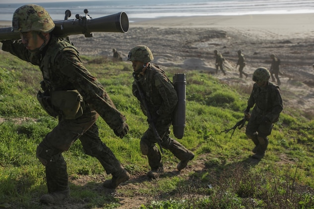 Marines with 1st Reconnaissance Battalion, 1st Marine Division, and members of the Japan Ground Self-Defense Force conduct amphibious raids and military operations on urban terrain during Exercise Iron Fist 15 aboard Camp Pendleton on Feb. 3, 2015. Exercise Iron Fist 15 is an annual bilateral training exercise between U.S. and Japanese military forces that builds their combined ability to conduct amphibious and land-based contingency operations. IF15, currently in its tenth iteration, is scheduled from Jan. 26 to Feb. 27, 2015, in southern California. (U.S. Marine Corps photo by Cpl. Angel Serna/Released)