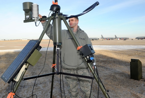 Staff Sgt. Tom Lapeer, 22nd Operation Support Squadron weather forecaster, checks the gages on a tactical weather observing system, Feb. 5, at McConnell Air Force Base, Kan. The observing system is one of many tools 22nd OSS meteorologists use to forecast weather in order to keep McConnell's personnel and equipment safe. (U.S. Air Force photo/Airman 1st Class Tara Fadenrecht)