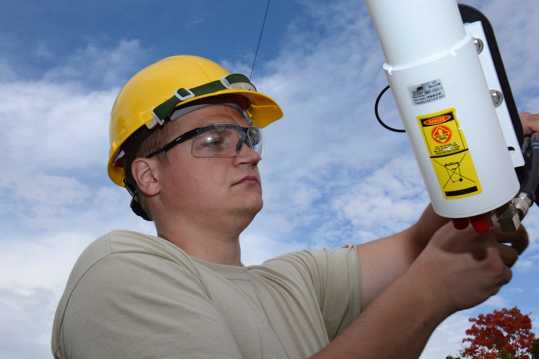 Senior Airman Cory Sachtjen, cyber infrastructure specialist for the Air National Guard's 115th Fighter Wing, performs initial acceptance testing on a Motorola omnidirectional point to point antenna at Truax Field in Madison, Wis., September 14, 2014. The antenna is part of a Joint Incident Site Communications Capability (JISCC) package the unit will use to augment the states Chemical, Biological, Radiological, Nuclear, and high yield Explosive Enhanced Response Force Package (CERFP). (U.S. Air National Guard photo by Master Sgt. Paul Gorman/Released)