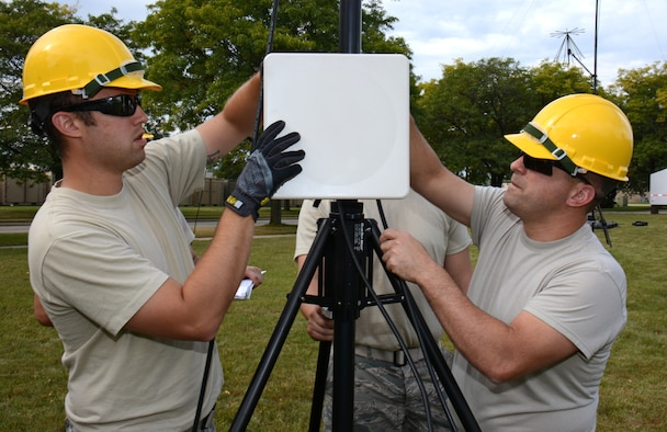 Tech. Sgt. Eric Anderson, left, and Master Sgt. Matthew Fisher, communications specialists for the Air National Guard's 115th Fighter Wing, perform initial acceptance testing on an Aruba flat panel antenna at Truax Field in Madison, Wis., September 14, 2014. The antenna is part of a Joint Incident Site Communications Capability (JISCC) package the unit will use to augment the states Chemical, Biological, Radiological, Nuclear, and high yield Explosive Enhanced Response Force Package (CERFP). (U.S. Air National Guard photo by Master Sgt. Paul Gorman/Released)
