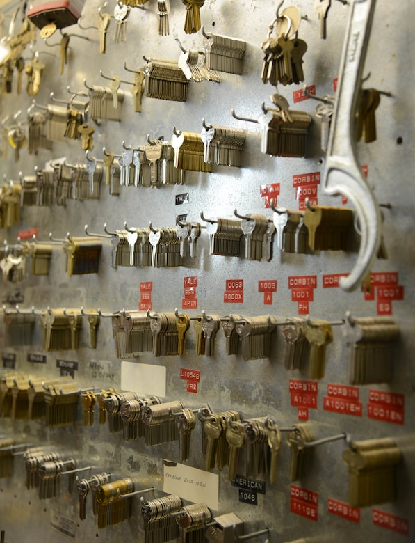 Dozens of different keys hang on a wall at the 341st Civil Engineer Squadron lock shop Feb. 3, 2015, at Malmstrom Air Force Base, Mont. Each key is used for different bands of locks and each has a specific number of tumblers it can work with. (U.S. Air Force photo/Airman 1st Class Dillon Johnston)