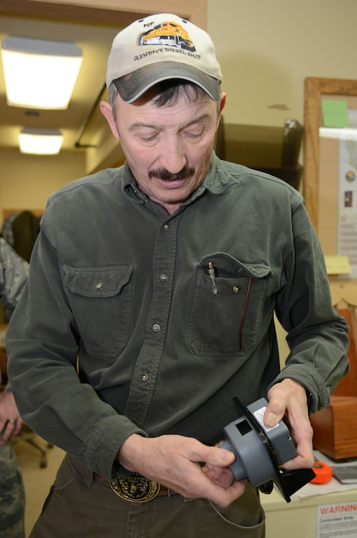 Jeff Kaul, 341st Civil Engineer Squadron locksmith, demonstrates how to use an electronic combination lock Feb. 3, 2015, at Malmstrom Air Force Base, Mont. Kaul maintains, installs and builds locks for all establishments on base. (U.S. Air Force photo/Airman 1st Class Dillon Johnston)