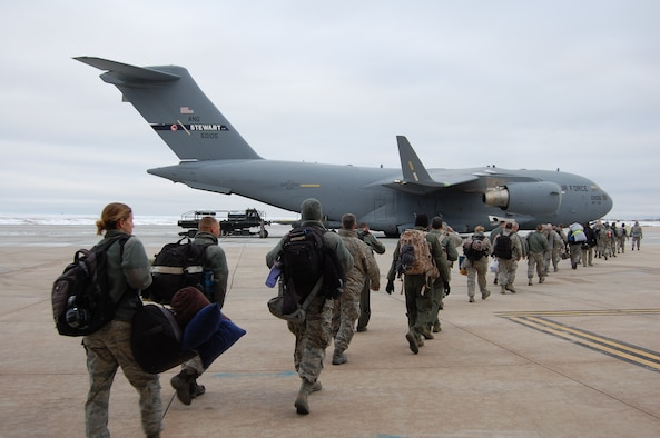 Members of the 140th Wing, Colorado Air National Guard, make their way into the C-17 that will take them on the first leg of their journey to South Korea February 4, 2015 at Buckley AFB, Colo. The 140th Wing is deploying as a theater security package in support of U.S. Pacific Command. (U.S. Air National Guard Photo by Capt. Kinder Blacke)