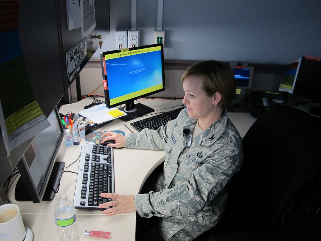 Col. Elizabeth Chamberlain, the Individual Mobilization Augmentee to the director of intelligence at 7th Air Force, brings a broad perspective on Air Force life and a specific knowledge of planned targeting to her intelligence community. In addition to her duties as an intelligence officer, this mother of two is a military spouse who actively volunteers with a number of women's leadership organizations, serves as an Air Force Academy Liaison Officer, and is actively involved in her community and kid's school. (U.S. Air Force Photo)